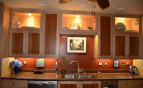 rustic kitchen cabinets and glass windows above kitchen