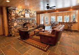 Splashy Stacked Stone Tile Trend Detroit Rustic Living Room Remodeling Ideas With Area Rug Armchairs Bar Seating Brown Leather Furniture Ceiling Fan Counter