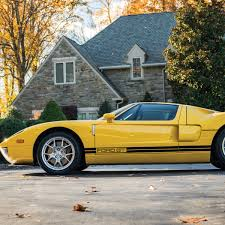 The 2006 Ford GT In The Driveway Under The Tree Automobiles