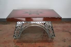 Metal Industrial Coffee Table On Wheels Standing In The Middle