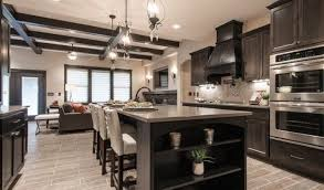 the story of kitchen cabinets with light countertops