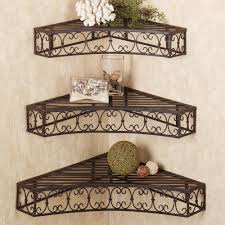 Bathroom Wall Shelves With Towel Bar by Freestanding Black Wrought Iron Shelf With Towel Bar On Grey Floor