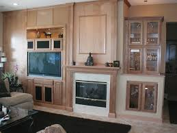 natural stone fireplace surround with brown wooden mantel shelf