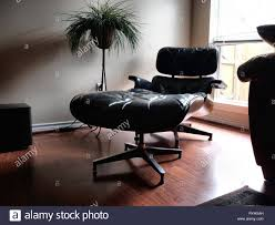 Eames Lounge Chair Stock Photos & Eames Lounge Chair Stock ... Eames Lounge Chair Walnut Brown Fniture Tables Chairs On Carousell Restoration Custom Home Design Stock Photos Chairstoria E Caratteristiche Di Unicona Tall In Santos Palisander Black Leather And Ottoman Interior Trade Blog Ghost For Holiday Filengv Design Charles Eames Herman Miller Lounge Atelier Designers Brands The Conran Wicker Midcentury Modern
