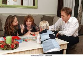 Happy Family Unit Playing Board Game On Christmas Eve
