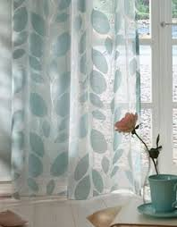 sheer white voile panel with a vertical stripe pattern mountain