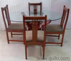 Excellent Condition Gently Used Teak Wood Glass Top 4 Seater Dining Quikr Certified