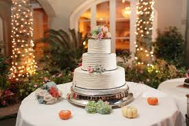 Guests Enjoyed A Three Tier Buttercream Cake Decorated With Beaded Icing Roses And