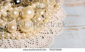 Shabby Chic Background For Wedding With Vintage Pearl Necklaces And Lace On Old Painted Wood