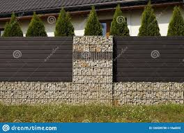 100 Gabion House The Is Surrounded By A Fence Made Of Among Others