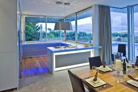futuristic kitchen design interior with blue led lighting set on