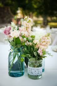 Beautiful Country Wedding Flowers Centerpieces In Transparent Blue Mason Jars Matched With Lovely White Lace