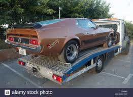 1970's Brown Ford Mustang Mach 1 Recovery Truck Stock Photo ... Confirmed 2018 Shelby Gt350 Mustang Ford Authority Global Truck War Ranger Vs Chevy Colorado Concept The A 2012 Gt Running Gear Dguised In 1964 F100 Meet The Super Snake And F150 Work Truck Faest Street Mustang In World Youtube Wrecked Lives On As Custom Rat Rod Ford Mustang V6 Velgen Wheels Vmb9 Matte Gunmetal 20x9 20x10 Inside Fords New 475hp Bullitt Pickup Edge St Motoring World Usa Takes 3 Awards At Sema With Hottest Watch Ram Truckbased 4x4 Hit By After Driver Polishes It During Traffic Stop
