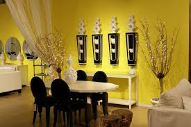 Cozy Dining Room With White Table And Black Chairs Beside Stunning Wall Decor Ideas On Yellow