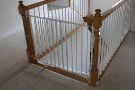 Installing A Baby Gate Without Drilling Into A Banister | Insourcelife Infant Safety Gates For Stairs With Rod Iron Railings Child Safe Plexiglass Banister Shield Baby Homes Kidproofing The Banister From Incomplete Guide To Living Gate For With Diy Best Products Proofing Montgomery Gallery In Houston Tx Precious And Wall Proof Ideas Collection Of Solutions Cheap Way A Stairway Plexi Glass Long Island Ny Youtube Safety Stair Railings Fabric Weaved Through Spindles Children Och Balustrades Weland Ab