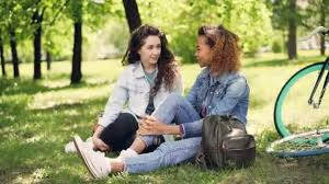 Beautiful Female Tourists Friends In Denim Clothing Are Having Rest After Riding Bikes Girls