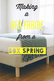 diy bed frame by adding simple legs and upholstery to box spring