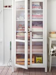 ikea smadal bookcase with glass doors line the back with pretty
