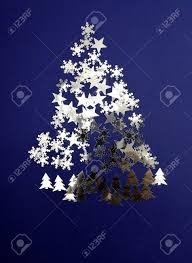 Xmas Tree In A Fantasy Of Fir Trees Stars Sky And Snow Stock Photo