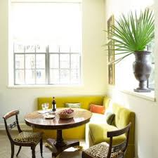 Inspiration For An Eclectic Medium Tone Wood Floor Dining Room Remodel In Charleston With White Walls
