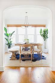 Layered Rug In Dining Room