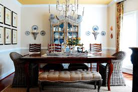 Chandelier Over Dining Room Table by Luxurious And Glamorous Dining Set With A Tufted Bench And Rattan