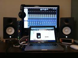 Above My Lil Home Editing Setup Apogee Mini Me MBox 2 Macbook Fostex T40s 2nd LCD Display And HS50s Astride DIYd Platform Isolators