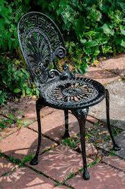 100 Black Wrought Iron Chairs Outdoor Cast Chair In The Garden Color Stock Photo