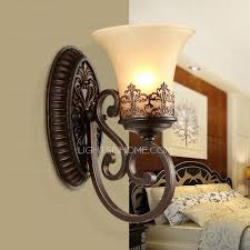 retro wall sconces and one light glass shade wrought iron