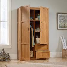 sauder beginnings storage cabinet highland oak with four