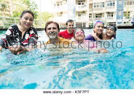 Happy Indian Family Bathing Swimming Pool Having Fun Apartment House