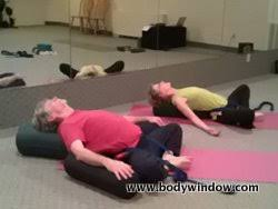 Bound Angle Pose With Yoga Bolsters And Strap