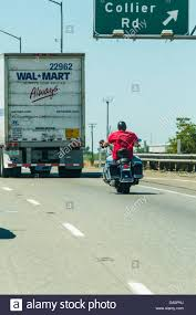 A Man On A Harley Davidson Motorcycle Behind A Walmart Truck On ... Walmart Loses Pay Fight With California Truck Drivers Ordered To Amazoncom Walmart Truck Carry Case 14 Die Cast Cars Toys Games Advanced Vehicle Experience Concept Youtube American Simulator America Doubles Atmpted Driver Found Bodies In At Texas Lived Louisville Truck Trailer Transport Express Freight Logistic Diesel Mack Combo Skin Peterbilt 579 And Trailer What Its Really Like Live The Parking Lot 25000 Grant Helps Food Pantry Buy New Belvidere