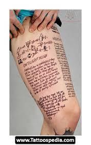 Script Tattoo On Left Thigh