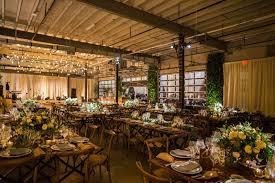 Warehouse Wedding Venue Rustic Decor Wood Tables Green White Centerpieces Light Bulb Dance Floor