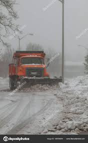 100 Trucks In Snow Plow Trucks Removing Snow On The Road Street During Blizzard