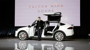 The Tesla Model X s Falcon Wing doors open even in the tightest spots