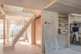 100 This Warm House Greenhouselike Extension Keeps This Minimalist Timber Home Warm In