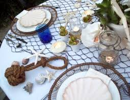 Nautical table decor with fish net and rope knot