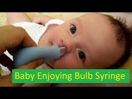 of baby enjoying bulb syringe