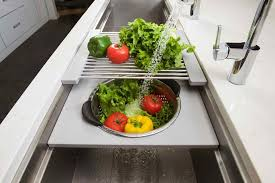kitchen unusual sink backing up on both sides how to unclog a