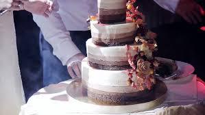 The Couple Cut Wedding Cake Rustic