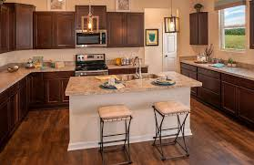 Drees Homes Floor Plans Dallas by Kitchen With Dark Cabinets An Island And Wood Floors The Ashton