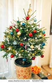 Small Christmas Tree With Lights A In Pot Decorated Balls Garlands And