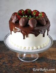 Chocolate Cake with Vanilla Filling and Frosting Ganache Topping and Chocolate Dipped Strawberries Whole