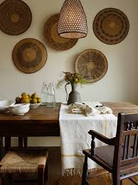 Awesome Dining Space With Honeycomb Lantern Decorative Wall Baskets Farmhouse Table Wood Bench And Seagrass Stools