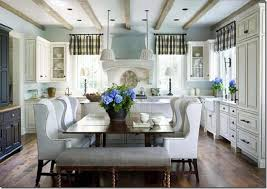 Cream Kitchen Banquette Attached To Island With Seating