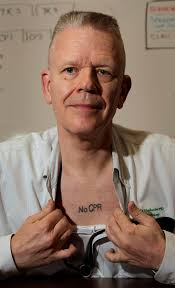 Kansas City Mo Pathologist Ed Friedlander Displays His Tattoo With A Medical Directive To
