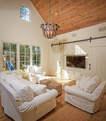 25 Ingenious Living Rooms That Showcase The Beauty Of Sliding Barn ... Beautiful Built In Ertainment Center With Barn Doors To Hide Best 25 White Ideas On Pinterest Barn Wood Signs Barnwood Interior 20 Home Offices With Sliding Doors For Closets Exterior Door Hdware Screen Diy Learn How Make Your Own Sliding All I Did Was Buy A Double Closet Tables Door Old