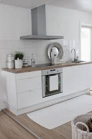 White Kitchen Ideas Pinterest by White Kitchen Light Timber Bench Floating Shelves Near Microwave